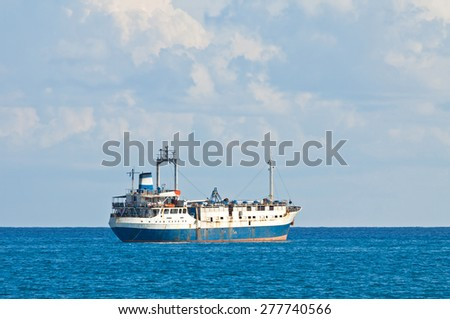 Ship in Mediterranean sea near Cyprus coast - stock photo