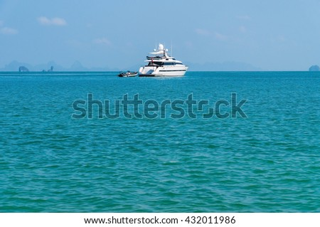 Ship in the beautiful sea with boat