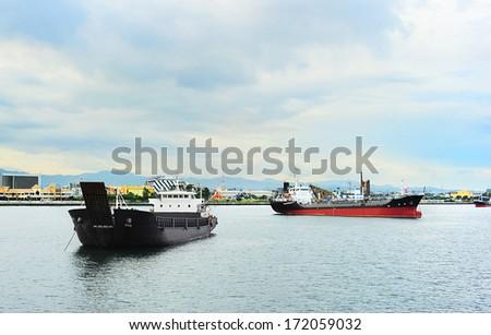 Ship in the industrial harbor. Cebu, Philippines - stock photo