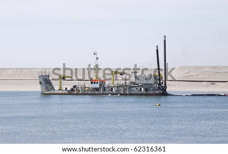 Ship in the water while creating a coast line. - stock photo