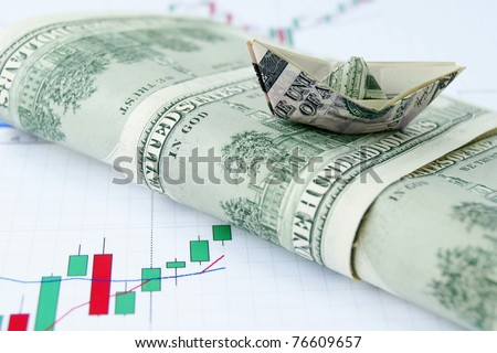 Ship made of money on wave of dollar notes on the exchange chart background - stock photo