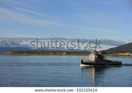 ship near the snow mountains Background - stock photo