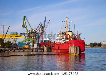 Ship protected against oil spills. - stock photo