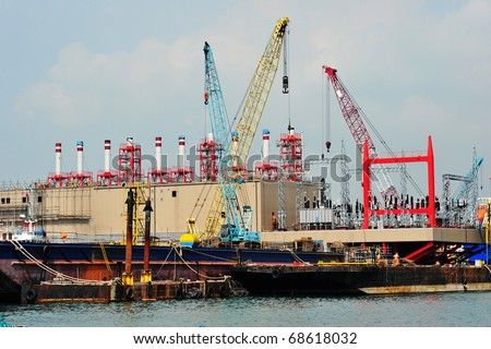 Ship Repair Yard With Cranes - stock photo