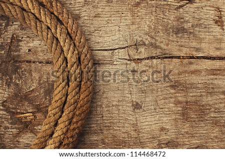 Ship rope and weathered wood background