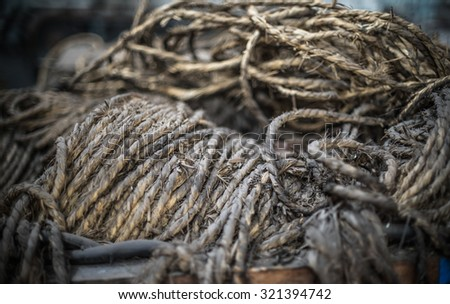 Ship ropes heap. Pile of various ropes and strings. Closeup of cordage. Background nautical texture - stock photo