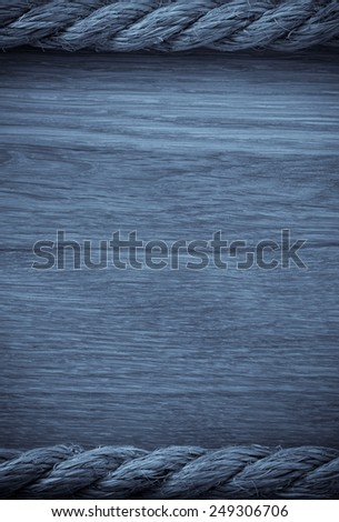 ship ropes on wooden background - stock photo