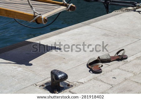 Ship's ladder and sandals at Mediterranean in Cannes, France