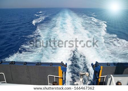 ship trail waves sun - stock photo