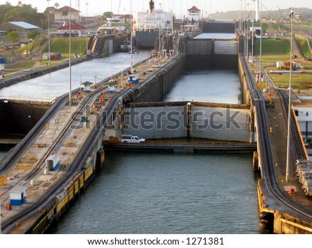 Ship transiting Panama Canal - Gatun Locks - stock photo