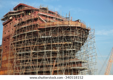 Ship under construction with scaffolding - stock photo