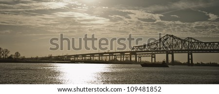 Ship with twin bridges over Mississippi River at New Orleans - stock photo