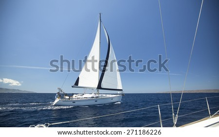 Ship yachts with white sails in the open Sea. Luxury boats. Sailing.  - stock photo