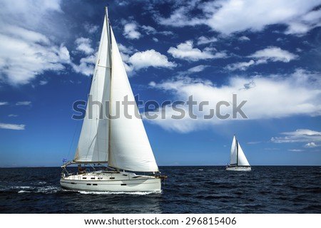 Ship yachts with white sails in the open sea. Sailing. Yachting. Luxury Lifestyle. - stock photo