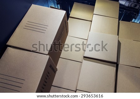 Shipment Delivery. Pile of Cartoon Boxes Inside Cargo Van Area. Courier Delivery. - stock photo