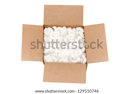 Shipping box with packing peanuts  isolated on white background with clipping path. - stock photo