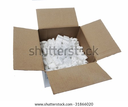 Shipping box with peanuts - stock photo