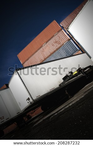 Shipping containers and truck trailers with Dutch tilt