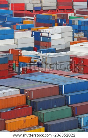 Shipping containers stacked at cargo port - stock photo