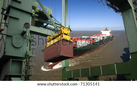 Shipping Industry abstract photo / container ship underway and container operation in port - stock photo