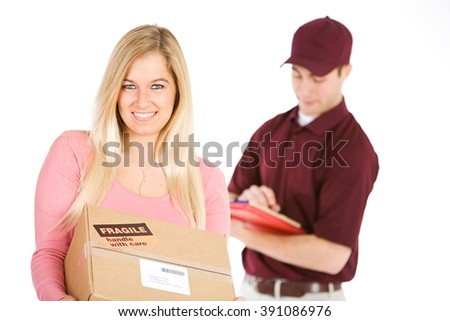 Shipping: Woman Receives Package From Delivery Man - stock photo