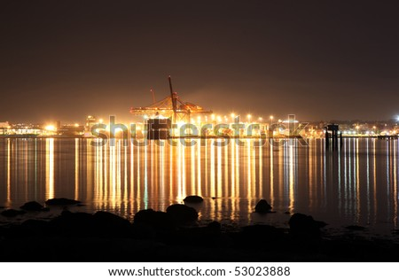 Shipping yards at night in Coal Harbor, Vancouver - stock photo