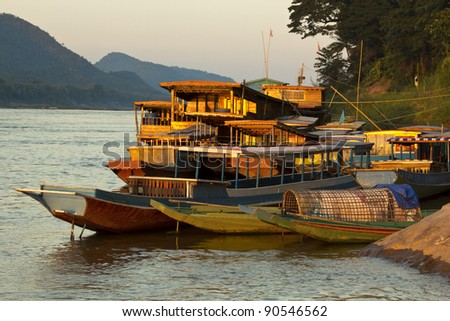 Ships and boats anchored on the river bank of the mekong river - stock photo