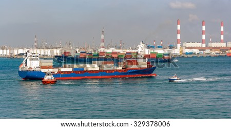 Ships and boats in front of an oil storage terminal on Jurong island, Singapore, Malaysia