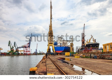 Ships and cranes in shipyard of Gdansk, Poland.  - stock photo