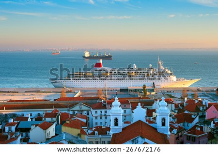 Ships in Lisbon harbor at sunset. Old Town buildings on foreground. Portugal - stock photo
