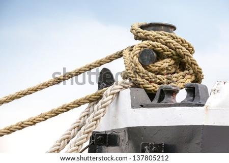 Ships mooring bollard with heavy duty mooring ropes - stock photo