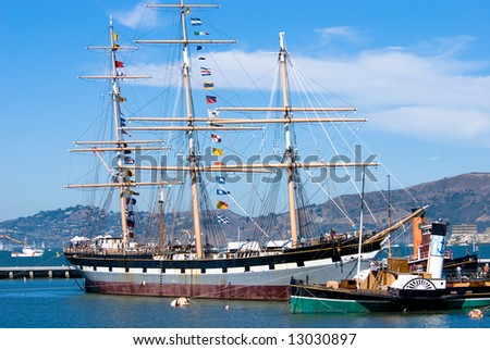 Ships of the San Francisco Maritime Museum in front of the Ghirardelli Square. - stock photo