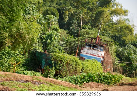 Shipwreck on riverbank of the Mekong river in Laos