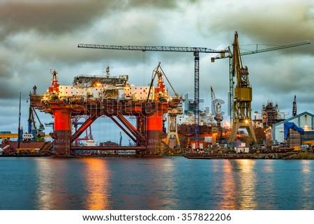 Shipyard industry - Oil Rig under construction in Gdansk, Poland. - stock photo