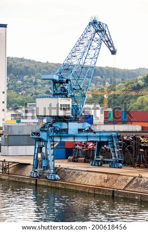 Shipyard with stacked cargo containers and cranes