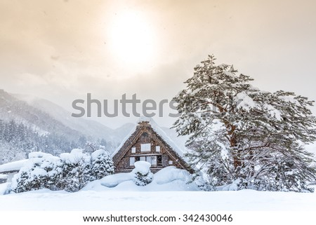 Shirakawago with Snowfall and winter Sun,  Gifu Chubu Japan - stock photo