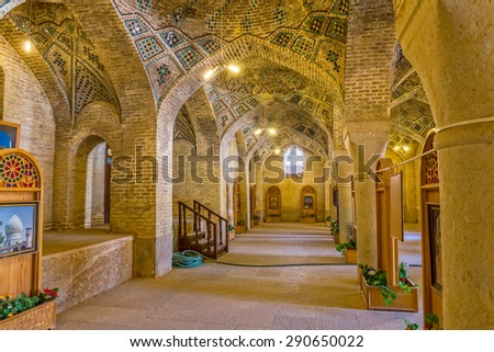 SHIRAZ, IRAN - MAY 2, 2015: Beautiful interior of the Nasir Al-Mulk Mosque or Pink Mosque a traditional mosque located in Goad-e-Araban place.