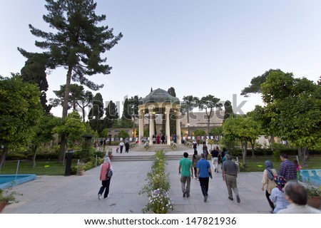 SHIRAZ, IRAN - MAY 25: Tomb of Poet Hafez: People are going to Hafez's tomb for pray. A tomb was erected to honor Hafez in the Musalla Gardens in Shiraz taken on May 25, 2013, Iran.