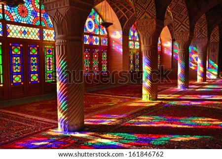 SHIRAZ, IRAN - OCTOBER 9: Nasir-ol-Molk Mosque on October 9, 2013 in Shiraz, Iran. Nasir-ol-Molk Mosque was built between 1871-1883 by order of Haj Hassan Ali Khan-e-Nasir -ol-Molk. - stock photo