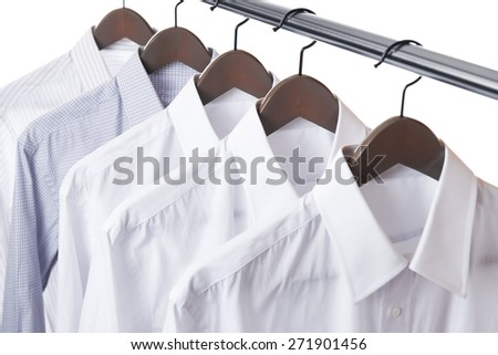 Shirt and hanger hang on a paul - stock photo