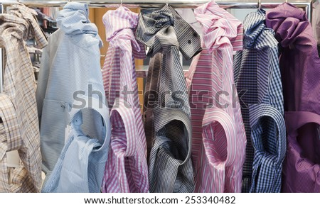 shirt on the hanger in different colors - stock photo