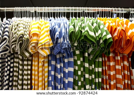 shirt row, colorful shirt arrange in a row in mall. - stock photo