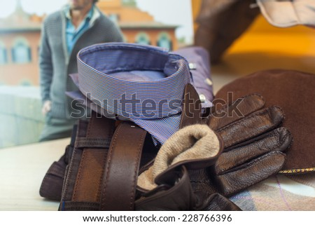 Shirt, slacks and leather gloves for man - stock photo
