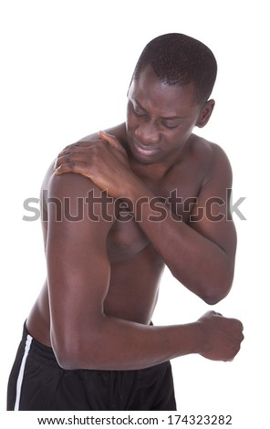 Shirtless African Young Man Suffering From Shoulder Pain - stock photo