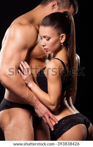 Shirtless bodybuilder embraces sexy girl. Shirtless athlete hugs fitness model. Warmth of lovers. Always missing each other. - stock photo