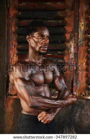 Shirtless handsome african bodybuilder - stock photo