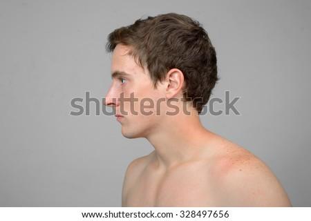 Shirtless man profile view - stock photo