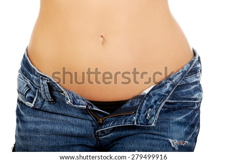 Shirtless woman with unbuttoned jeans.