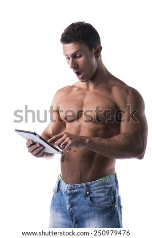 Shirtless young male bodybuiler holding ebook reader or tablet PC standing isolated on white background - stock photo