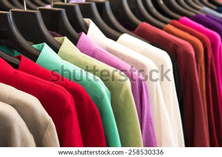 Shirts hanging on a rack - stock photo